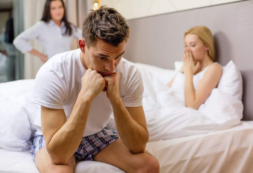 hotel, travel, relationships and sexual problems concept - wife caught man cheating with another woman